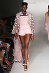 "Model walks runway in an outfit from the Binzario Couture Spring Summer 2017 ""Daydream"" collection by Luis Nazario and Andre Yabin, for the Designer's Collective Spring Summer 2017 fashion show during Fashion Gallery New York Fashion Week Spring Summer 2017 on September 10, 2016."