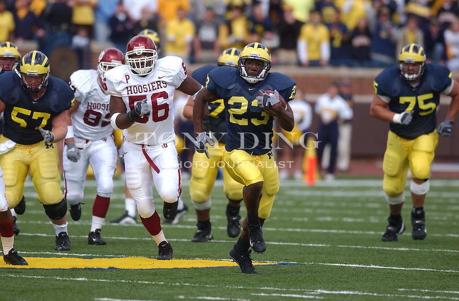 Michigan senior Chris Perry (23) rushes during the Wolverine's 31-17 win over Indiana on Friday, September 26, 2003 at Michigan Stadium in Ann Arbor, Mich. (TONY DING/Daily)