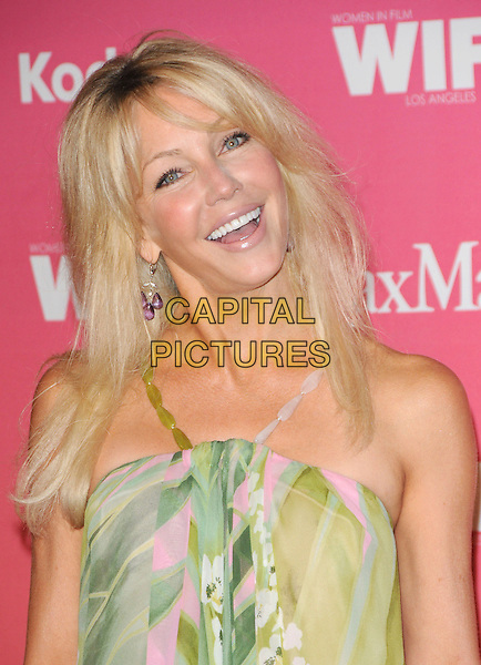 HEATHER LOCKLEAR .at The Women in Film 2009 Crystal .and Lucy Awards held at The Hyatt Regency Century Plaza in Century City, California, USA, June 12th 2009                                                                     .portrait headshot green pink print straps beads earrings fringe smiling .CAP/DVS.©Debbie VanStory/RockinExposures/Capital Pictures