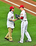 8 June 2010: Film producer Ken Burns is greeted by Washington Nationals' pitcher Drew Storen after throwing out the ceremonial first pitch prior to a game between the Washington Nationals and the Pittsburgh Pirates at Nationals Park in Washington, DC. The Nationals defeated the Pirates 5-2 in the series opener where pitching sensation Stephen Strasburg made his Major League debut, striking out 14 batters and notching his first win in the majors. Mandatory Credit: Ed Wolfstein Photo