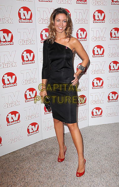 EMMA CROSBY .The TV Quick & TV Choice Awards, Dorchester Hotel, London, England. .September 7th, 2009 .full length dress one shoulder sleeve red shoes hand on hip black bracelet.CAP/BEL.©Tom Belcher/Capital Pictures.