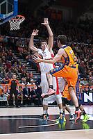 VALENCIA, SPAIN - 05/12/2014. Mitrovic del Estrella Roja y Vives del Valencia Basket durante el partido. Pabellon Fuente de San Luis, Valencia, Spain.
