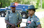 SOUTHBURY, CT-052118JS04--State Trooper Kelly Grant, right, holds a press conference with Trooper Josue Dorelus, left, near the scene of a standoff at a home on Purchase Brook Road in Southbury on Monday. <br /> Jim Shannon Republican American