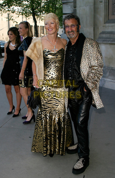 EDDIE JORDAN & WIFE.The Biba Ball at the Victoria & Albert Museum, London, UK..May 11th, 2006.Ref: AH.full length married husband necklace gold dress pattern leopard print jacket.www.capitalpictures.com.sales@capitalpictures.com.© Capital Pictures.