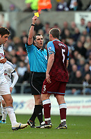 Pictured: Richard Dunne sees a yellow card from refereeNeil Swarbrick. Sunday 27 November 2011<br /> Re: Premier League football Swansea City FC v Aston Villa at the Liberty Stadium, south Wales.