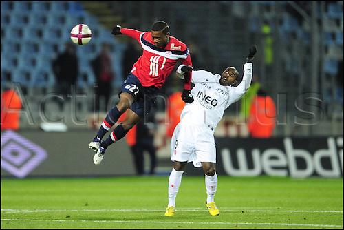 11.12.2011. Lille, France.  Aurelien Chedjou Lille and Brice jovial Dijon  French league division 1. Lille versus Dijon.