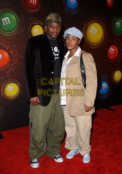OMAR EPPS & WIFE.Experience the Color of M&M's at M&M's Brand City held on the corner of Hollywood and Argyle in Hollywood, California .11 March 2004.*UK Sales Only*.full length, full-length.www.capitalpictures.com.sales@capitalpictures.com.©Capital Pictures.