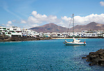 Yacht arriving in harbour at Playa Blanca, Lanzarote, Canary Islands, Spain