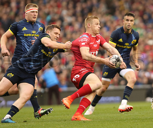 May 27th 2017, Aviva Stadium, Dublin, Ireland; Guinness Pro12 Rugby Final, Munster versus Scarlets;  Johnny McNicholl, Scarlets Rugby, is held by Munster's Rory Scanell