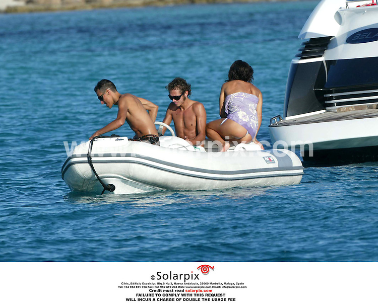 ALL ROUND PICTURES BY SOLARPIX.COM.*MUST CREDIT SOLARPIX.COM OR DOUBLE FEE WILL BE CHARGED*.**NO PUBLICATION IN SPAIN**.The world champion Italian motor cycle racing ace enjoying sun and quality time in Ibiza with his new girlfriend and his friends today...DATE:29_08_06-JOB REF:2756-MAD