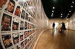 Supporters look at the Wall of the Dead at the Always Lost: A Meditation on War exhibit at Western Nevada College in Carson City, Nev., on Thursday, July 28, 2016. <br />