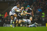 Mike Brown of Harlequins is tackled by Sailosi Tagicakibau of London Irish during the Aviva Premiership match between Harlequins and London Irish at Twickenham on Saturday 29th December 2012 (Photo by Rob Munro).
