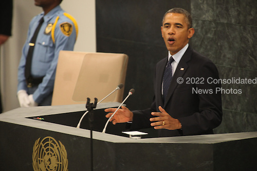 United States President Barack Obama delivers an address to the United Nations General Assembly in New York, New York on Tuesday, September 24, 2013.<br /> Credit: Allan Tannenbaum / Pool via CNP