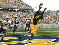 25 September 2004:  Chris Henry (5), West Virginia WR, catches a TD pass in the end zone during the 2nd quarter.<br /><br />West Virginia defeated James Madison 45-10 at Mountaineer Field at Milan Puskar Stadium in Morgantown, WV.<br />Mandatory Credit: Randy Litzinger