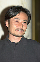 KIYOSHI KUROSAWA at Fantasia Festival<br /> <br /> <br /> Japanese film maker KIYOSHI KUROSAWA  get on stage to present his movie S…ANCE at Fantasia Film Festival, July 18 2001 in Montreal, CANADA <br /> <br /> Born in  1955 in  Kobe, He allready made about 30 movies of all kinds  :  horror, erotism, drama, action, Yakuza gangsters. The most famous beeing :<br /> Cure (1997), Barren Illusions (1999) and  Charisma (1999). He is one of the most productive and important film maker in contemporary Japanese cinema.<br /> <br /> Photo by Pierre Roussel / Getty Images News Service<br /> <br /> NOTE :  Nikon D-1 JPEG, opened with QUIMAGE ICC profile, saved as Adobe RG 1998