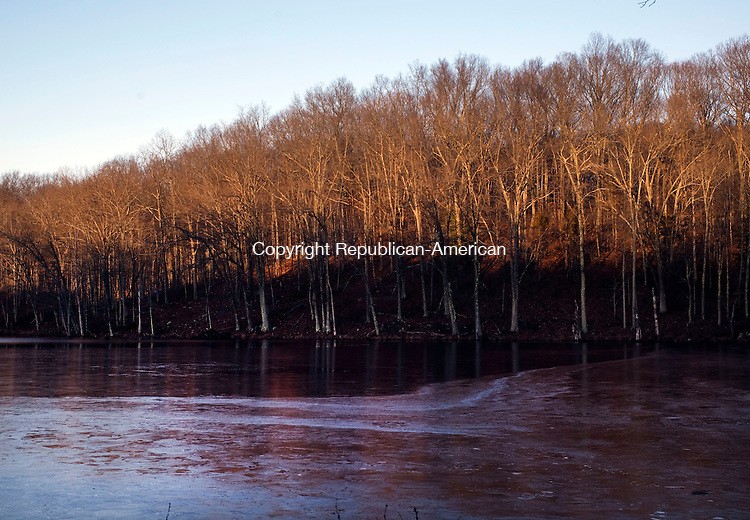 Woodbury, CT- 03 January 2016-010316CM01- COUNTRY LIFE--- A setting sun illuminates a pond along Old Sherman Hill Road in Woodbury on Sunday.   Christopher Massa Republican-American