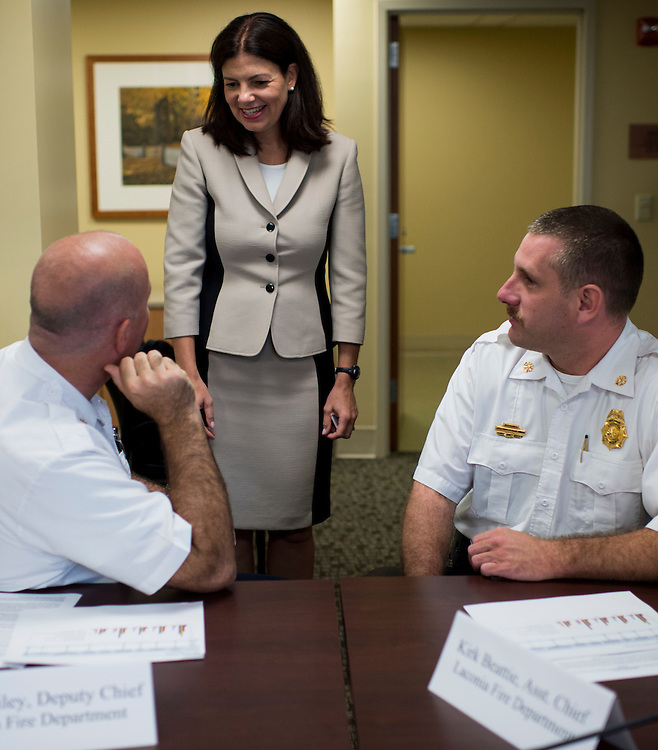 UNITED STATES - AUGUST 26: Sen. Kelly Ayotte, R-N.H., speaks with local fire officials before holding her heroin epidemic roundtable discussion at the Lakes Region General Hospital in Laconia , N.H., on Wednesday, Aug. 26, 2015. (Photo By Bill Clark/CQ Roll Call)