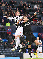 Steven Thompson (left) and Charlie Mulgrew challenge in the air in the St Mirren v Celtic Scottish Communities League Cup Semi Final match played at Hampden Park, Glasgow on 27.1.13.