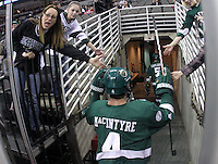 Valerie Rendle (front), mother of Bemidji State defenseman Sam Rendle, and Olivia Jones show their support for Dan MacIntyre and the Beavers as the team heads to the locker room after pre-game warmups. Bemidji State beat UNO 4-2 Friday night during the first round of the WCHA playoffs at Qwest Center Omaha. (Photo by Michelle Bishop)