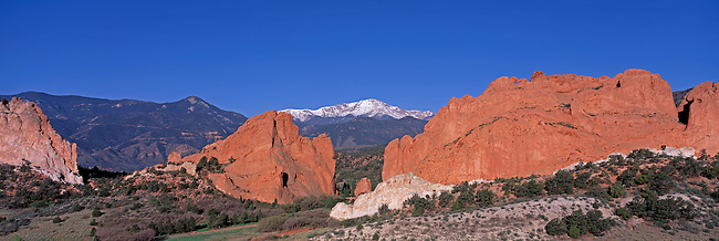 Morning light shines on Pikes Peak and several sandstone formations of the Garden of the Gods, Colorado Springs, CO