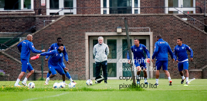 QPR training Sparky rallies the troops and even practises a few ball skills of his own after Sir Alex Ferguson suggest he would prefer to see Mark Hughes playing the crunch tie versus Man City on Sunday......Pic by Gavin Rodgers/Pixel 8000 Ltd