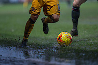 Action on the rain soaked pitch during the Sky Bet League 2 match between Newport County and Morecambe at Rodney Parade, Newport, Wales on 10 December 2016. Photo by Mark  Hawkins.