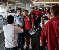 Landon Donovan  poses for photos with Mexican fan, U.S. Men's National Team vs. Mexico - August 11, 2009 at Estadio Azteca; Mexico City, Mexico.   .