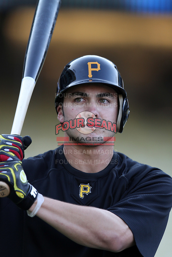 Pittsburgh Pirates shortstop Chase d'Arnaud #12 before a game against the Los Angeles Dodgers at Dodger Stadium on September 17, 2011 in Los Angeles,California. Los Angeles defeated Pittsburgh 6-1.(Larry Goren/Four Seam Images)