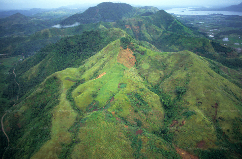 FLOODS & DEFORESTATION, Philippines. Ariel views of logging and deforestation causing massive landslides. Thousands of people died during flash floods in Leyte, the Philippines. Heavy rains brought floodwaters into river deltas where the poorest communities live, with  access to water; shanty towns, squatter camps were rapidly washed away.  The rapidity of flooding was blamed as much on logging and deforestation as the rain storms themselves. The Philippines, as the in rest of South East Asia, is rife with corruption amongst state, government and military officials who make a profit from illegal logging concessions.