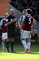Pictured: Match referee Howard Webb has a stern word with James Tomkins West Ham for a foul against Nathan Dyer of Swansea. 01 February 2014<br />