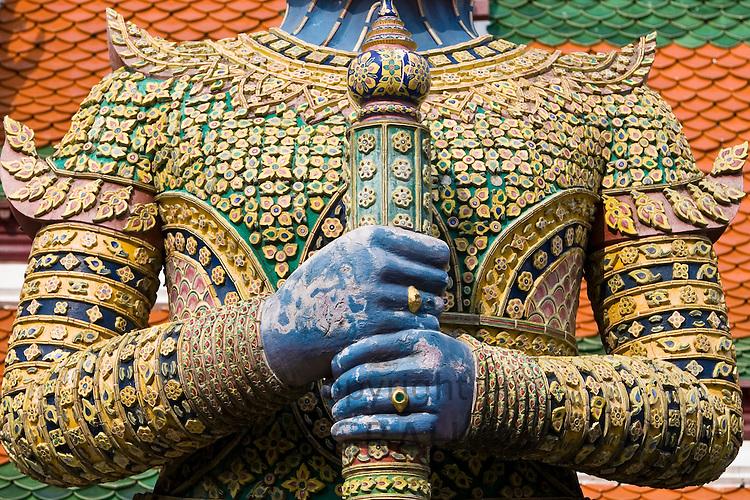 Indrajit Giant statue guards an entrance to Wat Phra Kaeo, Bangkok, Thailand