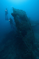 Couple (MR) exploring wreck, Palau, Micronesia.