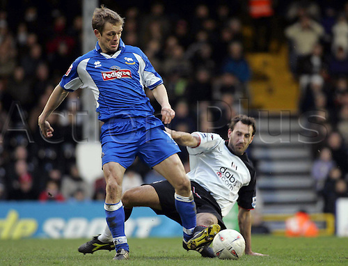 12 February 2005: Derby midfielder MORTEN BISGAARD tackled by SYLVAIN LEGWINSKI during the FA Cup 4th Round game between Fulham and Derby County played at Craven Cottage. Fulham won the game 4-2 Photo: Action Plus...football soccer 050212 player