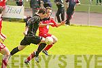Ballymac Galaxy's Cathal de'Lacey and Iveragh Utd's John Paul O'Mahony.