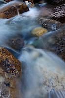 Detail shot of water cascading through rocks in Banff National Park