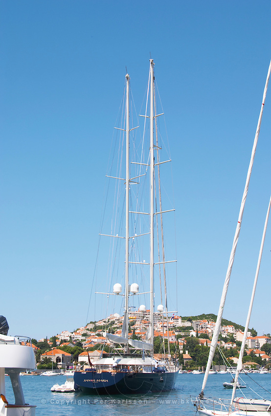 A very big luxurious pleasure sailing ship yacht with two masts, called Santa Maria leaving harbour. Luka Gruz harbour. Dubrovnik, new city. Dalmatian Coast, Croatia, Europe.