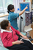 Nurse showing a patient the monitor of a dialysis machine on the Nottingham City Hospital Renal Unit,