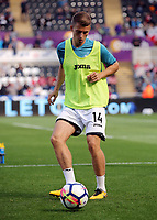 Tom Carroll of Swansea City warms up during the Premier League match between Swansea City and Watford at The Liberty Stadium, Swansea, Wales, UK. Saturday 23 September 2017