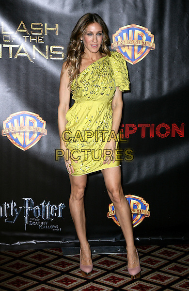 SARAH JESSICA PARKER .Warner Brothers ShoWest Presentation at the Paris Resort Hotel and Casino, Las Vegas, Nevada, USA..March 18th, 2010.full length green one shoulder dress sjp sleeve pink shoes silver beads beaded .CAP/ADM/MJT.© MJT/AdMedia/Capital Pictures.