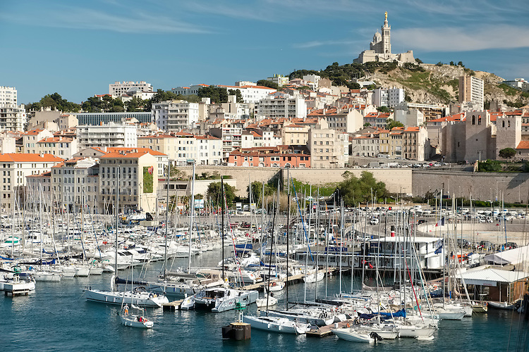 Overseen by the landmark of Basilique Norte-Dame de la Garde, the Old Port is carpeted with an incredible mass of sailing boats.