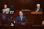 Nevada Lt. Gov. Mark Hutchison, left, and Assembly Speaker John Hambrick, R-Las Vegas, right, listen as Republican Rep. Joe Heck speaks to a joint session at the Legislative Building in Carson City, Nev., on Monday, March 30, 2015. <br /> Photo by Cathleen Allison