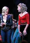 Olivia Newton John and Ashley Spencer during bows as Olivia Newton-John is headed back to Rydell High to promote Breast Cancer Awareness after the Curtain Call for GREASE at the Brooks Atkinsoon Yheatre in New York City. <br />
