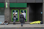 Rough sleeper outside Lloyds Bank, Moorgate, Islington, London.