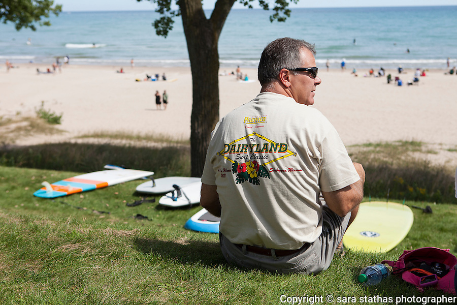 A spectator watches the action at the country's largest freshwater surf event taking place Labor Day weekend in Sheboygan, Wisconsin.