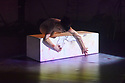 """Berwick-Upon-Tweed, Northumberland, UK. 14.09.2018. Shobana Jeyasingh Dance perform """"Contagion"""", in the Gymnasium Gallery, Berwick-Upon-Tweed Barracks and Main Guard. """"Contagion"""" is directed and choreographed by Shobana Jeyasingh, with projection design by Nina Dunn, lighting design by Yaron Abulafia, and set and costume design by Merle Hensel. <br /> Contagion is co-commissioned by 14-18 NOW, the UK's arts programme for the First World War centenary.<br /> <br /> Contagion commemorates the 1918 Spanish Flu pandemic, which killed more people than the First World War itself. The piece is inspired by the nature and spread of the flu virus, the unseen enemy that mankind was battling within, while engaging in more conventional warfare in the world outside. The striking work of the Austrian artist Egon Schiele, who fell victim to the Spanish flu, forms a visual footnote to the piece.<br /> <br /> Set to an atmospheric soundscape, this dance installation with digital visuals echoes the scientific features of a virus – rapid, random and constantly shape-shifting. Eight female dancers contort and mutate as they explore both the resilience and the vulnerability of the human body.<br /> <br /> This is a standing performance presented in unusual venues, many with connections to the First World War. The dancers are: Vânia Doutel Vaz, Eva Escrich Gonzalez, Emily Pottage, Rachel Maybank, Estela Merlos, Avatâra Ayuso, Sunbee Han, Ruth Voon. Photograph © Jane Hobson."""
