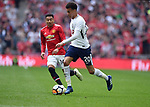 Dele Alli of Tottenham Hotspur is challenged by Jesse Lingard of Manchester United during the FA cup semi-final match at Wembley Stadium, London. Picture date 21st April, 2018. Picture credit should read: Robin Parker/Sportimage