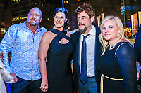 "NEW YORK - NOVEMBER 14:  Benicio Del Toro and Patricia Arquette pose with guests at a party following the premiere of Showtime's limited series ""Escape at Dannemora"" at Alice Tully Hall in Lincoln Center on November 14, 2018 in New York City. (Photo by Kena Betancur/Showtime/PictureGroup)"