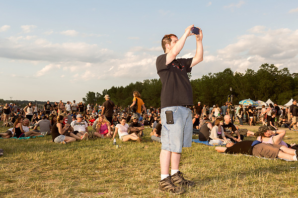 May 8, 2016. Concord, North Carolina. <br />  A fan records the Deftones show.<br />  The 2016 Carolina Rebellion was held over May 6-8 next to the Charlotte Motor Speedway and featured over 50 bands including headliners Lynyrd Skynyrd, The Scorpions, Five Finger Death Punch, Disturbed, and Rob Zombie.
