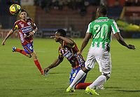 PASTO -COLOMBIA, 15-10-2014. Mauricio Mina (Izq) jugador del  Deportivo Pasto disputa un balón con Miller Mosquera (Der) jugador del Atlético Nacional por la fecha 11 Liga Postobón II 2014 jugado en el estadio La Libertad de Pasto./ Mauricio Mina (L) player of Deportivo Pasto vies for the ball with Miller Mosquera (R) player of Atletico Nacional for the 11th date of Postobon  League II 2014 played at La Libertad stadium in Pasto. Photo: VizzorImage / Leonardo Castro / STR