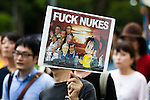 August 6, 2011 - Tokyo, Japan - A protestor holds a anti-nuclear message board as he marches on the streets in downtown Tokyo. August 6 marks the 66th anniversary of the US atomic bombing of Hiroshima in 1945 as Japan still continues to struggle to end the nuclear crisis since the March 11 earthquake and tsunami. (Photo by Christopher Jue/AFLO)